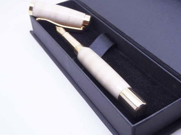 Pen with cap off and gift box
