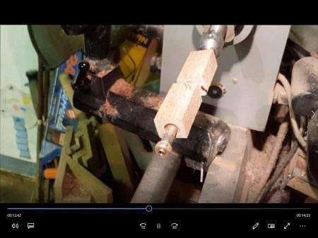 Place Wood On Mandrel To Make A Wooden Pen